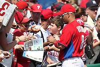 Philadelphia Phillies outfielder Shane Victorino #8 signs autographs before a scrimmage against the Florida State Seminoles at Brighthouse Field on February 29, 2012 in Clearwater, Florida.  Philadelphia defeated Florida State 6-1.  (Mike Janes/Four Seam Images)