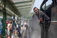 BNPS.co.uk (01202 558833)<br /> Pic: ZacharyCulpin/BNPS<br /> Date taken: 22/07/2021<br /> <br /> Jon at Swanage Railway station<br /> <br /> Weather input<br /> <br /> If you think your office is hot spare a thought for Swanage Railway fireman Jon Cooper. Jon has to deal with temperatures of up to 45 degrees as he shovels coal into the fire of a 1920's U Class steam locomotive<br /> <br /> It's a busy time of year for the heritage railwayline as holiday makers enjoy 5 mile trips by the Dorset coast which can startfrom Norden to Corfe Castle and down to the Victoria seaside town of Swanage (pictured)