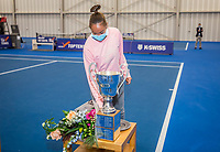 Amstelveen, Netherlands, 20  December, 2020, National Tennis Center, NTC, NK Indoor, National  Indoor Tennis Championships, Women's  Single Winner  :  	<br /> Lesley Pattinama-Kerkhove (NED) picks up her winners trophy<br /> Photo: Henk Koster/tennisimages.com