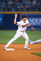 Nashville Sounds shortstop Chad Pinder (11) turns a double play during a game against the Iowa Cubs on May 3, 2016 at First Tennessee Park in Nashville, Tennessee.  Iowa defeated Nashville 2-1.  (Mike Janes/Four Seam Images)