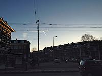 Early morning contrails in the Jordaan neighbourhood.<br /> <br /> Photo Kees Metselaar