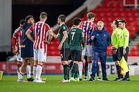 23rd December 2020; Bet365 Stadium, Stoke, Staffordshire, England; English Football League Cup Football, Carabao Cup, Stoke City versus Tottenham Hotspur; Tottenham Hotspur Head Coach Jose Mourinho celebrates the win with Son Heung-min as Spurs players shake hands with Stoke counter-parts