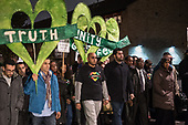 Family and friends of victims of the Grenfell Tower fire disaster lead a monthly silent walk, North Kensington, London.