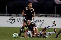 Leslie Osborne tries to get back up are her collision with Marta (white) with teammate Greer Barnes in the back. FC Gold Pride tied the Los Angeles Sol 0-0 at Buck Shaw Stadium in Santa Clara, California on July 23, 2009.