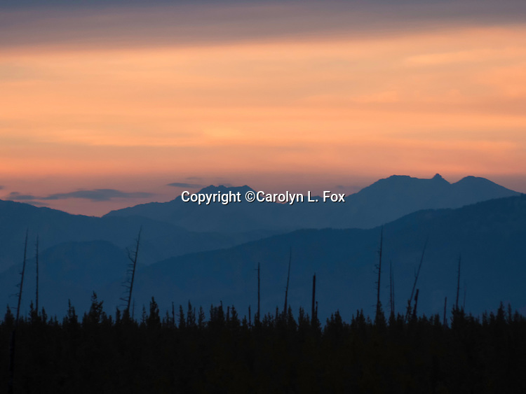 The sun sets over mountains in Yellowstone National Park.
