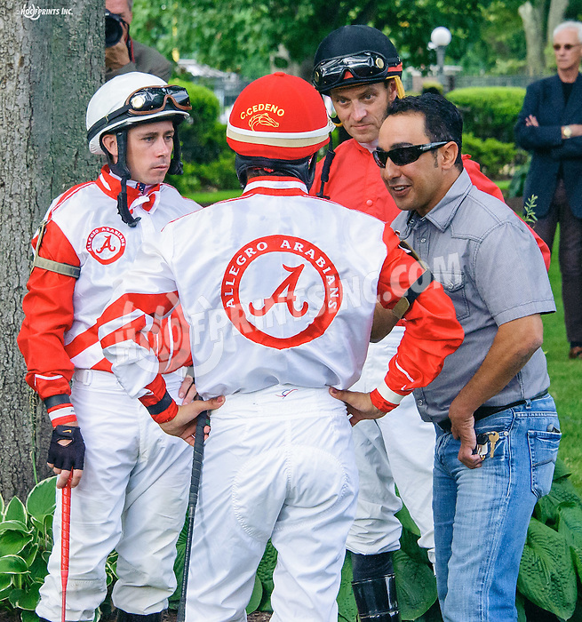 Guy Smith discussing strategy with his team of jockeys before The Delaware Park Arabian Oaks (grade II) at Delaware Park on 8/6/16