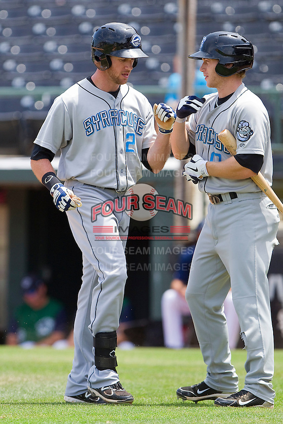 Corey Brown #21 of the Syracuse Chiefs celebrates with teammate Matt Antonelli #17 after hitting a home run on the first pitch of the game against the Charlotte Knights at Knights Stadium on June 19, 2011 in Fort Mill, South Carolina.  The Knights defeated the Chiefs 10-9.    (Brian Westerholt / Four Seam Images)