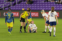 ORLANDO, FL - JANUARY 22: Referee, Danielle Chesky checks on an injured Sam Mewis #3 during a game between Colombia and USWNT at Exploria stadium on January 22, 2021 in Orlando, Florida.
