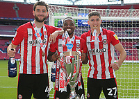 Charlie Goode, Tarique Fosu and Vitaly Janelt of Brentford celebrate winning the Championship Play-Off Final during Brentford vs Swansea City, Sky Bet EFL Championship Play-Off Final Football at Wembley Stadium on 29th May 2021