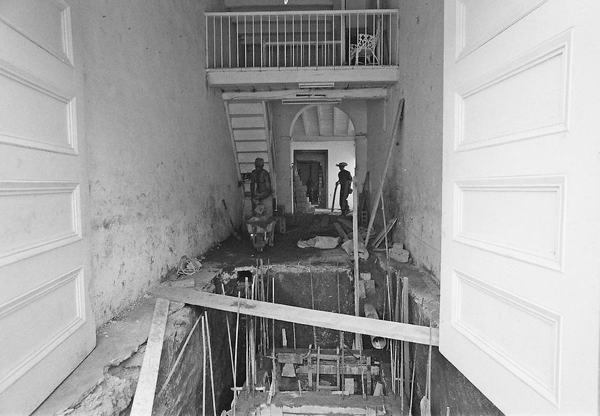 Labourers renovate a home in Trinidad, Cuba. MARK TAYLOR GALLERY