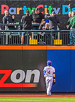 20 April 2013: New York Mets outfielder Collin Cowgill can only watch an Adam LaRoche home run clear the fences during game action against the Washington Nationals at Citi Field in Flushing, NY. The Mets fell to the visiting Nationals 7-6, tying their 3-game weekend series at one a piece. Mandatory Credit: Ed Wolfstein Photo *** RAW (NEF) Image File Available ***