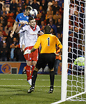 Jon Daly rises above Airdrie Captain Darren McCormack to score his first competive goal for Rangers