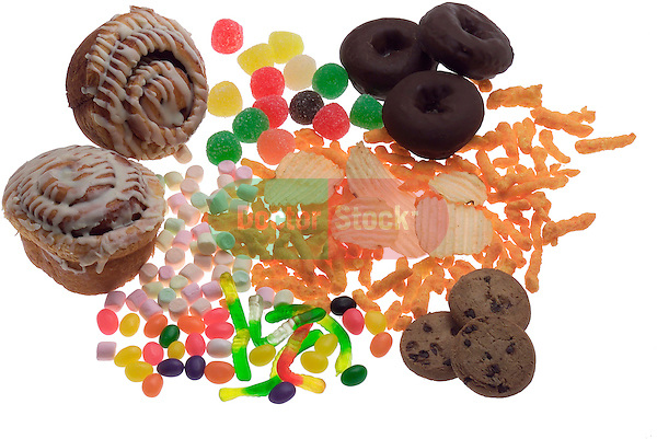 high calorie snack foods, pastries, donuts, cookies, chips, gum drops, cheese puffs, marshmallows on shadowless white background