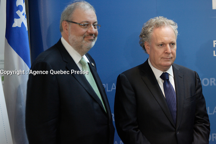 Montreal (Qc) CANADA - February 5 2012 File Photo - Jean Charest, Premier of Quebec (R) and , Pierre Arcand, Environment Minister (L) unveil the PLAN NORD about mining development in Northen Quebec