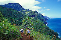 Couple sees views of the Na Pali Coast along the Kalalau Trail, Kauai