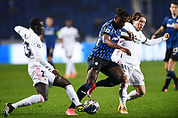 Luka Modric and Ferland Mendy of Real Madrid and Duvan Zapata of Atalanta BC compete for the ball during the Champions League round of 16 football match between Atalanta BC and Real Madrid at Atleti azzurri d'Italia stadium in Bergamo (Italy), February, 24th, 2021. Photo Image Sport  / Insidefoto