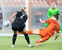 HOUSTON, TX - SEPTEMBER 10: Kealia Watt #2 of the Chicago Red Stars shot on goal is blocked by Haley Hanson #9 of the Houston Dash during a game between Chicago Red Stars and Houston Dash at BBVA Stadium on September 10, 2021 in Houston, Texas.