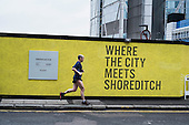 Where the City meets Shoreditch.  A property development site on the border between the City of London and Hackney, an area undergoing major redevelopment and gentrification.