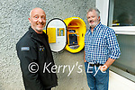 Paul Horan (Ballymac Vintage Committee) and Mick Bolger (Principal of Scoil Nuachabháil Ballymac) standing next to the new Defibrillator at Scoil Nuachabháil Ballymac on Tuesday evening, which was gifted by the Ballymac Vintage Committee to the community of Ballymac. The eircode for the defibrillator is V92KX44.
