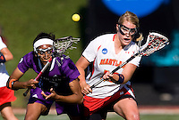 Karri Ellen Johnson (18) of Maryland fights for the ball with Taylor Thornton (9) of Northwestern during the NCAA Championship held in Johnny Unitas Stadium at Towson University in Towson, MD.  Maryland defeated Northwestern, 13-11, to win the title.