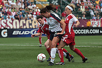 USWNT's Lauren Cheney (19, ctr) fights for control against Canada's Diana Matheson (8, left) and . The U.S. Women's National Team defeated 1-0 in a friendly match at Marina Auto Stadium in Rochester, NY on July 19, 2009. Abby Wambach of the USWNT scored her 100th career goal in the second half..
