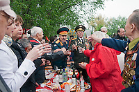 Moscow, Russia, 09/05/2012..Military veterans and friends and family make toasts as Russian World War Two veterans and well-wishers gather in Gorky Park during the countrys annual Victory Day celebrations.
