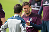 Frank Lampard of England looks dejected during training