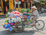 Women do a lot of the heavy lifting in Vietnam, many plying their trades on the street from bicycles or pushcarts or carrying heavy loads with bamboo carrying poles.
