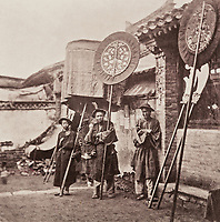 BNPS.co.uk (01202 558833)<br /> Pic: ForumAuctions/BNPS<br /> <br /> Pictured: Thomson spent four years, photographing landmarks, scenery and the native population.<br /> <br /> Rarely seen 150 year old photos taken by one of the first British photographers to explore China have emerged for sale for £20,000.<br /> <br /> Scotsman John Thomson (1837-1921) travelled to the Far East in 1868 and established a studio in Hong Kong, using it as a base to explore remote parts of the vast country for the next four years, photographing landmarks, scenery and the native population.<br /> <br /> In many cases, he was the first Westerner the people he photographed had encountered.<br /> <br /> One striking image shows a prisoner in chains with a head poking through a board covered in Chinese symbols, perhaps listing his misdemeanours. In another, a man poses next to a giant camel statue in the grounds around the Ming tombs of the Forbidden City.<br /> <br /> Almost 100 of his photos feature in a rare first edition of 'Thomson Illustrations of China and Its People' (1873), which is going under the hammer with London-based Forum Auctions.