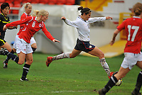 USA forward Carli Lloyd strikes a shot.  The USA defeated Norway 2-1 at Olhao Stadium on February 26, 2010 at the Algarve Cup.