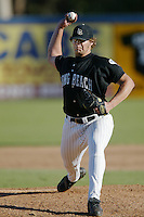 Josh Alliston of the Long Beach State Dirtbags pitches during a 2002 season NCAA game at Blair Field in Long Beach, California. (Larry Goren/Four Seam Images)