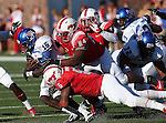 Southern Methodist Mustangs defensive tackle DARRIAN WRIGHT (54) and Southern Methodist Mustangs linebacker RANDALL JOYNER (5) tackle Memphis Tigers quarterback ERIC MATTHEWS (15) during the game between the Memphis Tigers and the Southern Methodist Mustangs at the Gerald J. Ford Stadium in Dallas, Texas. Memphis defeats SMU 48 to 3.
