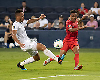 KANSAS CITY, KS - JUNE 26: Jonathan Lewis #18 makes a cross against Francisco Palacios #2 during a game between Panama and USMNT at Children's Mercy Park on June 26, 2019 in Kansas City, Kansas.