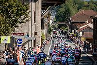 peloton rolling through town<br /> <br /> Stage 17 from Grenoble to Méribel - Col de la Loze (170km)<br /> <br /> 107th Tour de France 2020 (2.UWT)<br /> (the 'postponed edition' held in september)<br /> <br /> ©kramon