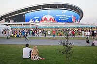 KAZAN, RUSSIA - June 24, 2018: Spectators take in the scene outside Kazan Arena before their 2018 FIFA World Cup group stage match between Colombia and Poland.