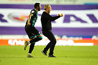 Steve Cooper Head Coach of Swansea City celebrates at full time with Rhian Brewster during the Sky Bet Championship match between Reading and Swansea City at the Madejski Stadium in Reading, England, UK. Wednesday 22 July 2020.