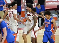 Arkansas forward Jaylin Williams (10) celebrates Tuesday, Feb. 16, 2021, with forward Justin Smith (0) and guard Davonte Davis during the second half of the Hogs' 75-64 win over Florida in Bud Walton Arena. Visit nwaonline.com/210217Daily/ for today's photo gallery. <br /> (NWA Democrat-Gazette/Andy Shupe)
