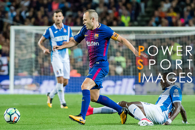 Andres Iniesta Lujan (L) of FC Barcelona fights for the ball with Papakouli Diop (R) of RCD Espanyol during the La Liga match between FC Barcelona vs RCD Espanyol at the Camp Nou on 09 September 2017 in Barcelona, Spain. Photo by Vicens Gimenez / Power Sport Images