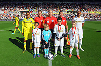 Saturday, 06 October 2012<br /> Pictured: Match officials with team captains and children mascots.<br /> Re: Barclays Premier League, Swansea City FC v Reading at the Liberty Stadium, south Wales.