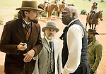 Calvin Candie (Leonardo DiCaprio), Dr. King Schultz (Christoph Waltz), Stephen (Samuel L. Jackson) and Jamie Foxx (Django) in Django Unchained...- Editorial Use Only -..Supplied by face to face