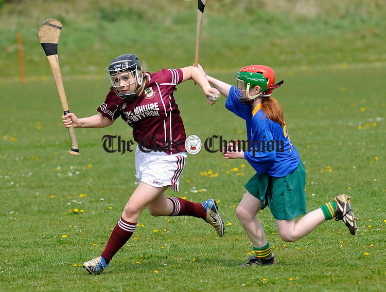 Mary Daly of Ennistymon is tackled by Killaloe's Emer O Shea during the schools camogie blitz at St Flannan's. Photograph by John Kelly.