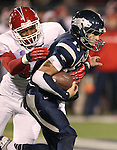 Nevada's Cody Fajardo (17) is put under pressure by Fresno State's Tristan Okpalaugo (88) during the first half of an NCAA college football game in Reno, Nev., on Saturday, Nov. 10, 2012. (AP Photo/Cathleen Allison)