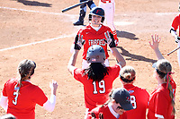 GREENSBORO, NC - FEBRUARY 22: Haley Updegraff #5 of Fairfield University celebrates scoring a run with her teammates during a game between Fairfield and North Carolina at UNCG Softball Stadium on February 22, 2020 in Greensboro, North Carolina.