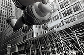 New York, New York<br /> November 26, 2009<br /> USA<br /> <br /> The Macy's Thanksgiving Day Parade in mid-town Manhattan, as Buzz Light-year and other children's cartoon character balloons float through the skyscrapers on 6th Avenue and 42nd Street. Crowds gather to mark the beginning of the Christmas season.