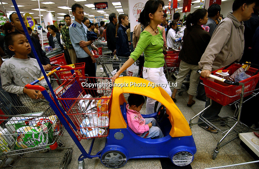 A kid rides a special shopping cart at the busy Wal-mart superstore in the center of Kunming, capital of Yunnan Province, China. An Introduction to Wal-Mart. In 1996, Wal-Mart entered the Chinese market nowadays operate 45 units in 21 cities across the mainland..08 Jul 2005