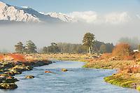 Waitangitaona River near Whataroa with fresh snow on mountains in background, West Coast, South Westland, New Zealand