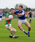 Shane Hickey of  Kilmurry Ibrickane in action against Liam Markham of Cratloe during their senior football final replay at Cusack park. Photograph by John Kelly.
