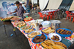 Nicaraguan man cooks local delicacies at food stand behind La Catedral in Leon, Nicaragua