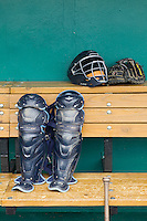 Corpus Christi Hooks catchers gear in the dugout on May 10, 2015 at Nelson Wolff Stadium in San Antonio, Texas. The Missions defeated the Hooks 6-5. (Andrew Woolley/Four Seam Images)
