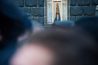 Politicians closed from protestors inside Ministry building observe the crowd. Kiev. Ukraine. Thousands of people are continuing to express their support to european integration and protesting against decision of Ukrainian government to refuse signing of association with EU in Vilnius.